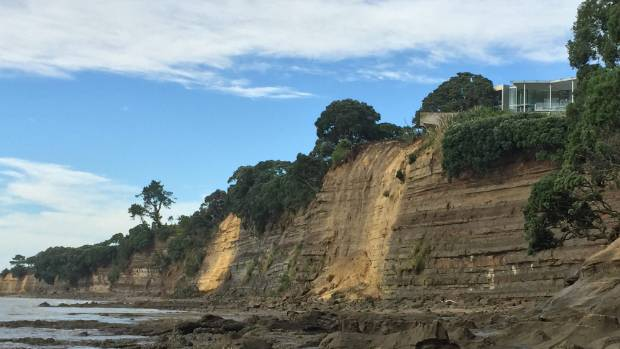 """Truckloads"" of cliff have fallen onto the beach below, firefighters say."
