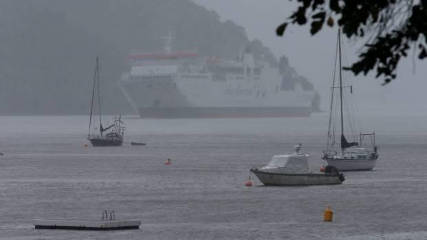 The Interislander ferry arrives in Picton as heavy rain falls on Wednesday morning.