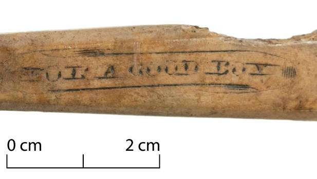 """The inscription on this bone cutlery handle reads """"for a good boy""""."""