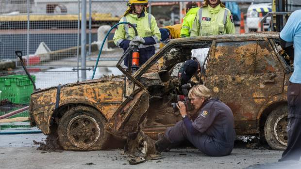 Police continue to investigate Leo Lipp-Neighbours car after it was lifted from the bottom of Nelson Harbour on Tuesday ...