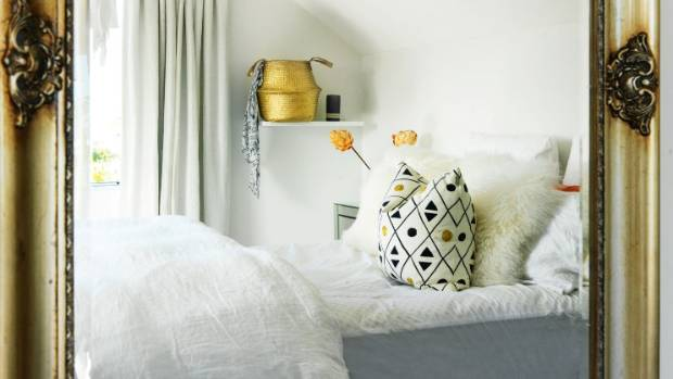 The basket on the floating shelf in Abby and Dan's bedroom was spray-painted gold; the room gets a lot of natural ...