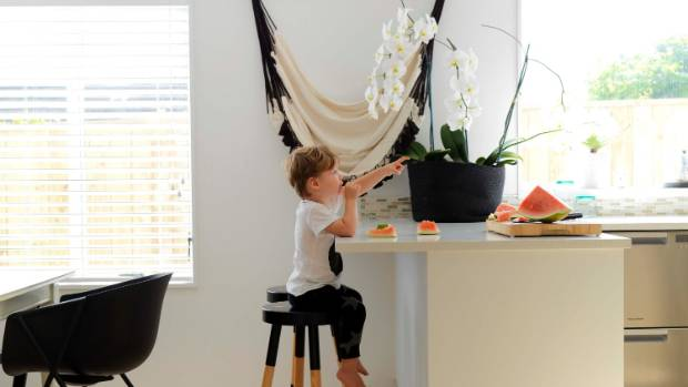Huey sits on a Y stool by Tim Webber Design; Abby decided the Citta hammock would look better as a wall hanging.