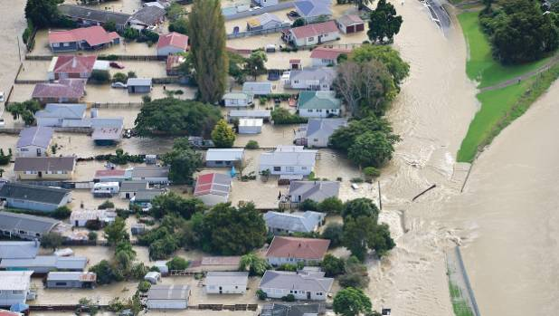 Water gushes into Edgecumbe through a breach in the Rangitaiki River stopbank.