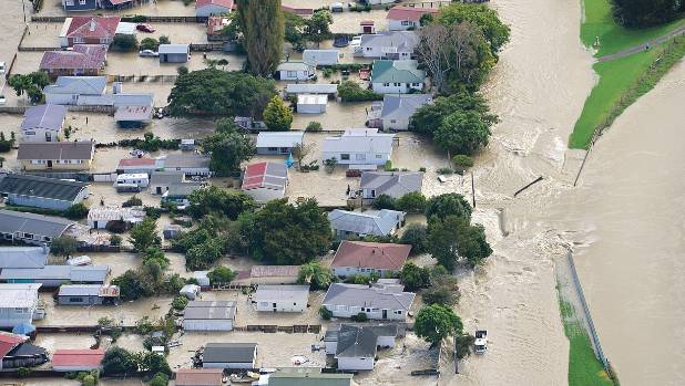 Water flows into Edgecumbe through a breach in the Rangitaiki River stopbank on Thursday morning.