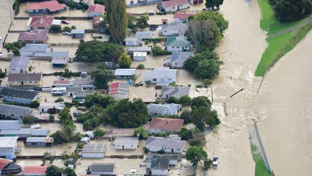 Water flows into Edgecumbe through a breach in the Rangitaiki River stopbank shortly before 9am Thursday.