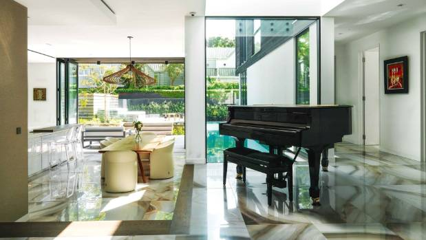 The baby grand piano, played by Jessie's mother and niece, looks out to the lap pool and decks, with a backdrop of ...