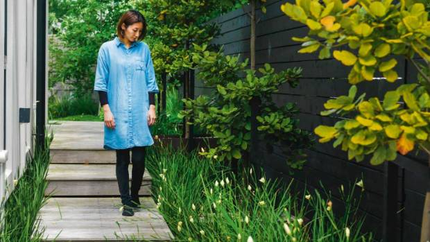 Jessie Sun in her Auckland garden.