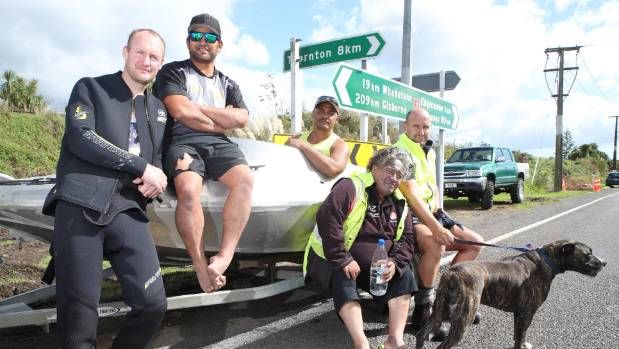 Dwayne Macguire, John Puutu, Kipa Fowell, Roy Rogers and Jason Hubbard (along with the dog) have been helping rescue ...