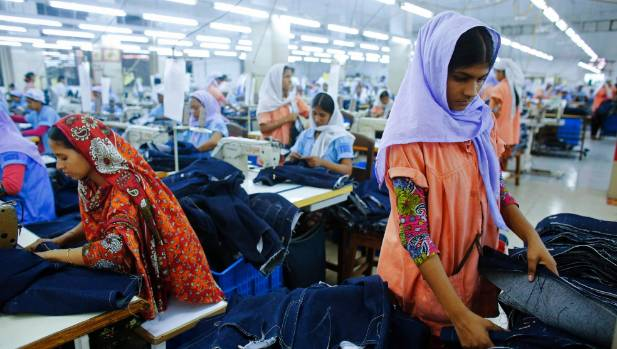 Workers sort clothes at a garment factory near the collapsed Rana Plaza building in Savar, Bangladesh.