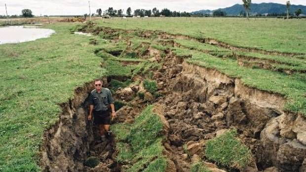 A scientist standing in the rift created by the 1987 Edgecumbe quake.