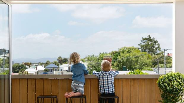"""Tadhg and Macdara look west from the outdoor bar: """"This is one of our favourite views, looking over all the old roofs; ..."""