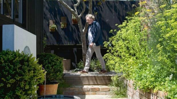 Roger walks over the concealed sandpit.