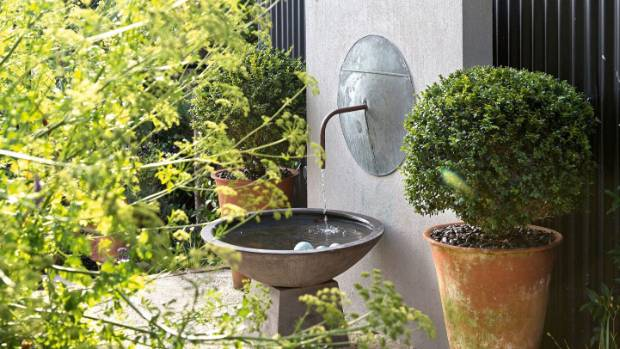 The water feature was designed and built by landscape designer Renée.