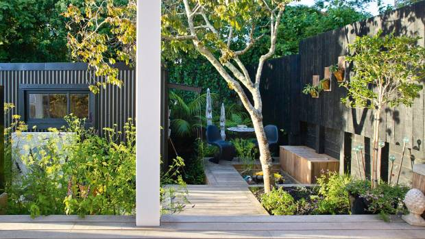 Landscape designer Renée Davies managed to incorporate a variety of areas into the small space, including a ...