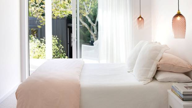 The couple's bedroom opens onto the garden; the pink twist pendants are from nearby Monmouth Glass Studio – Roger went ...