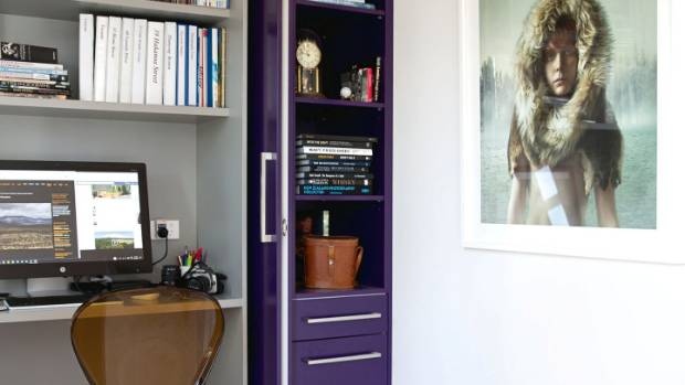 "Roger's concealed study was designed by Peter Hay; he chose the purple doors: ""I wanted some colour!""; the photograph is ..."