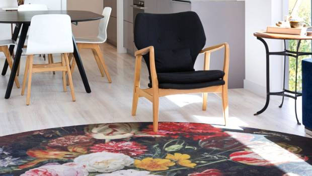 The dining table and chairs are from BoConcept, the armchair and lamp in the living area are from Citta, and the Eden ...