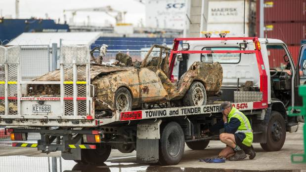 Leo Lipp-Neighbour's car is loaded on a tow truck on Thursday afternoon before being taken to a secure facility.