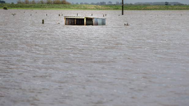 Sheds are almost submerged when farms were flooded on Main Drain Rd, Rangiotu.