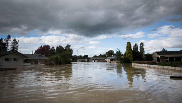 The flood bank protecting Edgecumbe in the Bay of Plenty breached today, flooding the township.