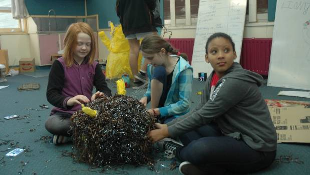 Upper Hutt primary school Year 6 students Charli Mokomoko, left, Olivia Withers and Genna Nero at work on their LUX Kids ...