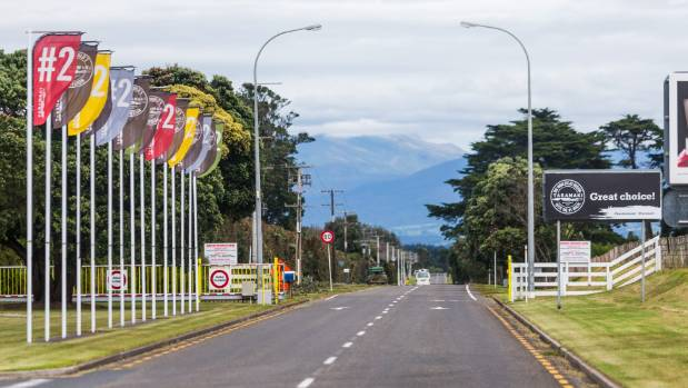 Signs and flags about Taranaki being the number 2 region in the world as voted by Lonely Planet.