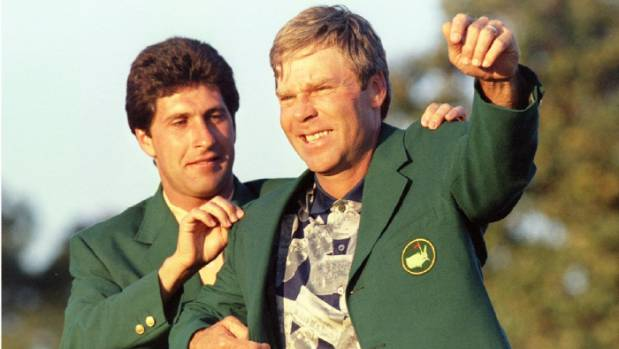 Ben Crenshaw has his second green jacket fitted by 1994 champion Jose Maria Olazabal after winning an emotion-laden 1995 ...