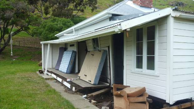 A small tsunami inflicted damage to the much-loved Little Pigeon Bay cottage in the wake of last year's Kaikoura earthquake.