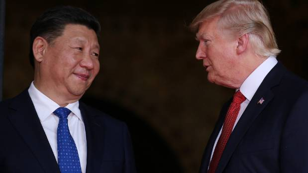 US President Donald Trump welcomes Chinese President Xi Jinping at Mar-a-Lago state in Palm Beach on Friday.