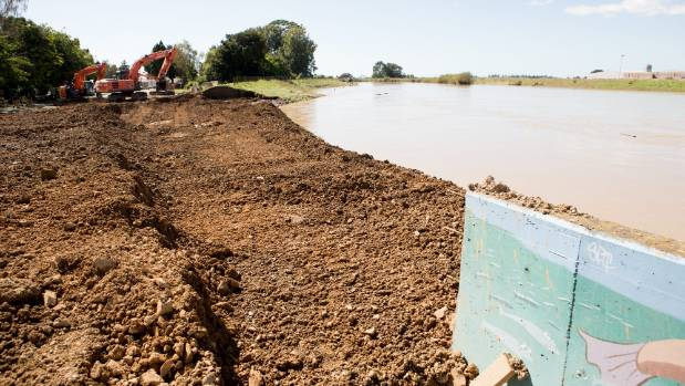 Diggers managed to plug the breach at 11pm on Friday night. A stream of 13 trucks continue to pour dirt from a local ...