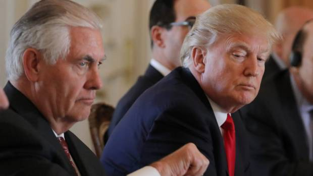 US Secretary of State Rex Tillerson, left, listens as President Donald Trump speaks during a bilateral meeting with ...