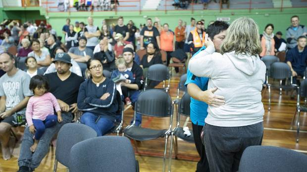 Edgecumbe residents console one another during the emergency meeting.