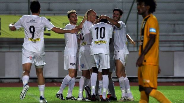Team Wellington celebrate Andy Bevin's goal against AS Magenta on Saturday night in Noumea.