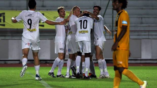 Team Wellington celebrate taking the lead for the first time in the match against AS Magenta thanks to Andy Bevin's goal.