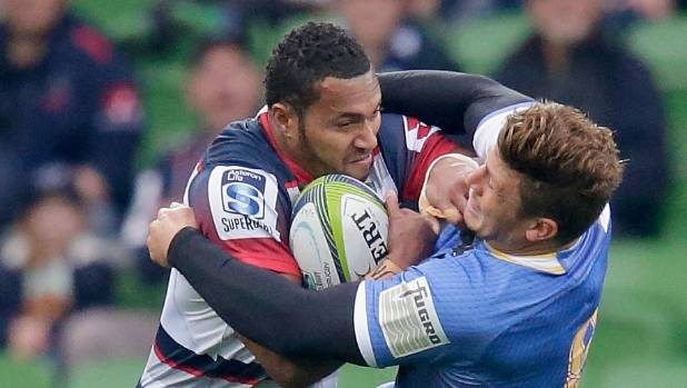 Sefanaia Naivalu of the Rebels, left, breaks a tackle during their match against the Force this season. The futures of ...