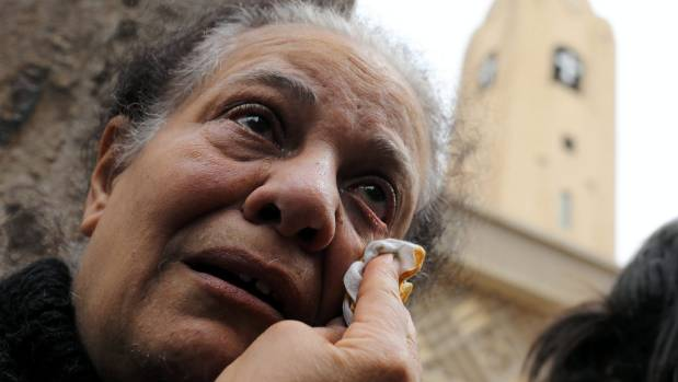 A relative of one of the victims reacts after a deadly church explosion in Tanta.