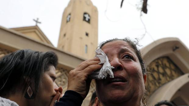 A relative of one of the victims reacts after a church explosion in Tanta, Egypt, April 9, 2017.