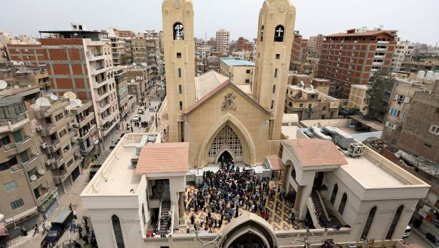 Egyptians gather by a Coptic church that was bombed on Sunday.