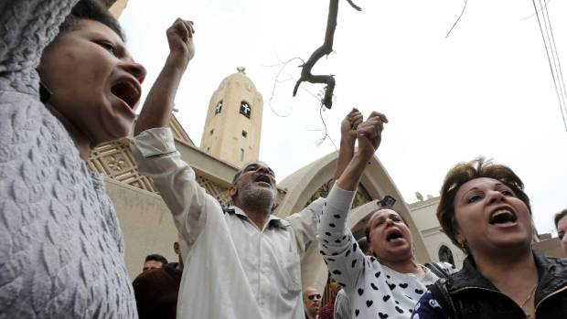 Relatives of victims react in front of a Coptic church that was bombed on Sunday in Tanta, Egypt.