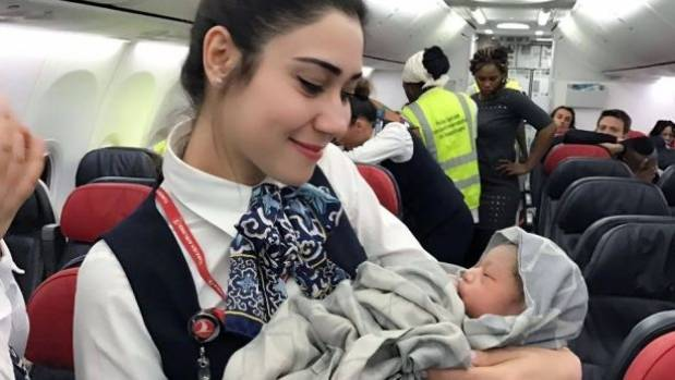Airline crew delivers baby girl mid-flight