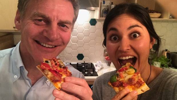 Prime Minister Bill English savours a slice of pizza with celebrity chef Nadia Lim.