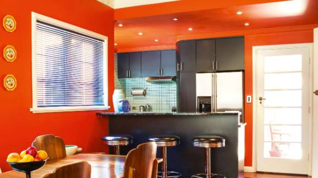 The kitchen is painted in a custom-tinted orange, inspired by the work of art deco ceramicist Clarice Cliff (three ...