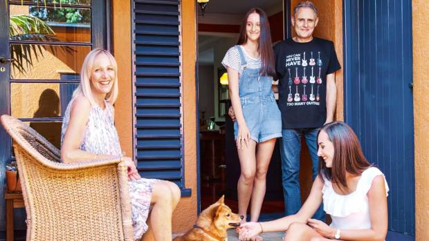 Archie, the Finnish spitz, joins, from left, Megan, Ella, Bruce and Hannah in the home's internal courtyard.