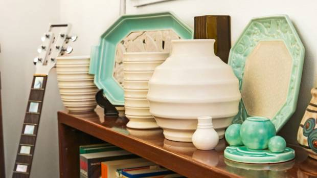 Items from the couple's collections of Poole, Keith Murray and Crown Lynn ceramics in the family living area.