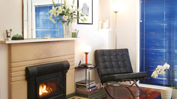 The living area features an original terrazzo fireplace retrofitted with a wood-burner; indigo blue Luxaflex blinds, ...