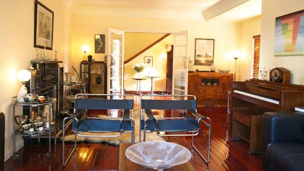 The formal living room, looking towards the entry foyer and stairs; a pair of 1930s Wassily chairs divide the space.