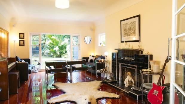 An Edwardian-era polar bear rug, known as Harry, guards the formal living room of Bruce and Megan Sedcole's Wellington ...