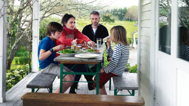Alexandra Tylee and Chris Morris and their boys on the well-used verandah; the trestle table and benches are from ...
