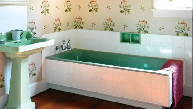 The basin and bath are original, and the Sanderson wallpaper has also been used in Pipi.
