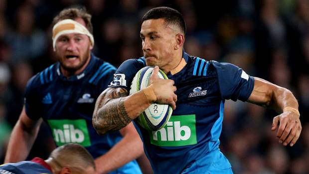Sonny Bill Williams in action for the Blues against the Highlanders with tape over the bank logo on his jersey collar.
